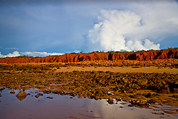 Late afternoon storms build behind the red pindan cliffs at James Price Point, 60km north of Broome., site of a proposed LNG processing hub. The distinctive red pindan is caused by iron particles.