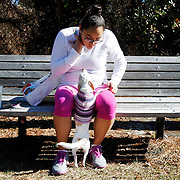 Tanya Wadgymar, of Toronto, center, gazes towards Cleo, her friends puppy, while eating lunch on a bench in Hilton Head Island on January 16, 2014.  Wadgymar is in Hilton Head Island visiting friends.