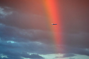 © Licensed to London News Pictures. 29/07/2013. London, UK. A plane flies past a colourful rainbow in West London sky this evening, 29 July 2013. Photo credit : Stephen Simpson/LNP