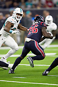 Houston Texans running back Lamar Miller (26) is chased by Miami Dolphins defensive end Robert Quinn (94) as he runs for a third quarter gain of 58 yards and a first down at the Miami Dolphins 9 yard line during the NFL week 8 regular season football game against the Miami Dolphins on Thursday, Oct. 25, 2018 in Houston. The Texans won the game 42-23. (©Paul Anthony Spinelli)