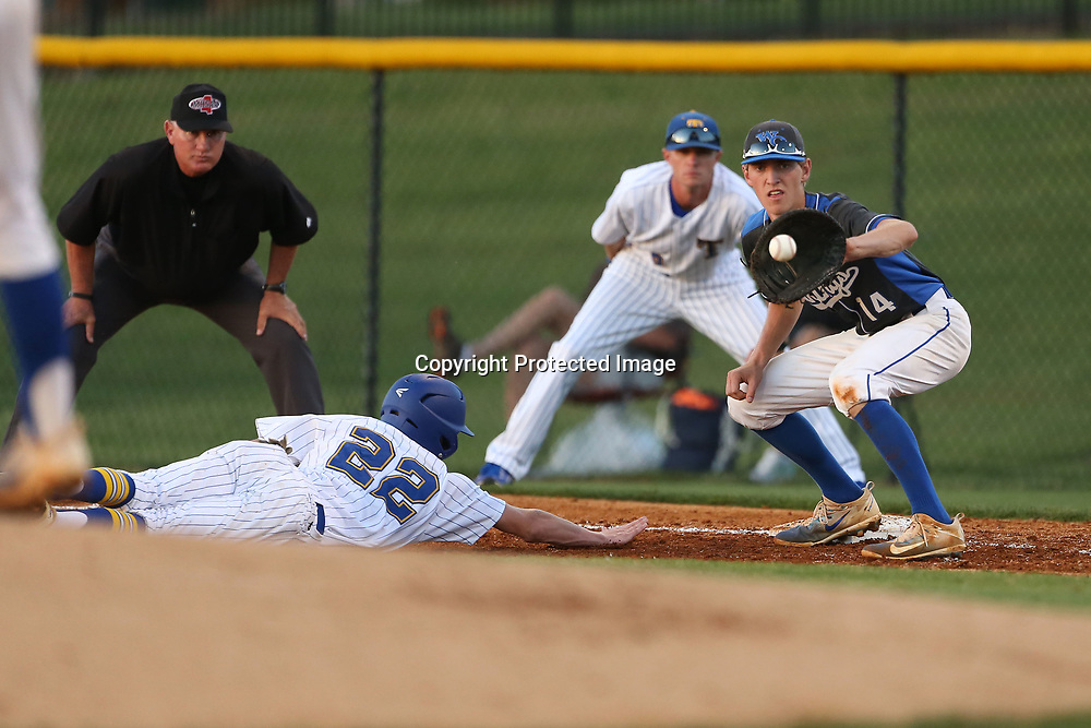 Warren Central first baseman Matthew Newcomb look for the out on Tupelo base runner Gatlin Farrar. Farrar was safe at the plate.