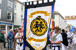 The banner of the Golowan Band at the Mazey Day celebrations in Penzance, Cornwall.