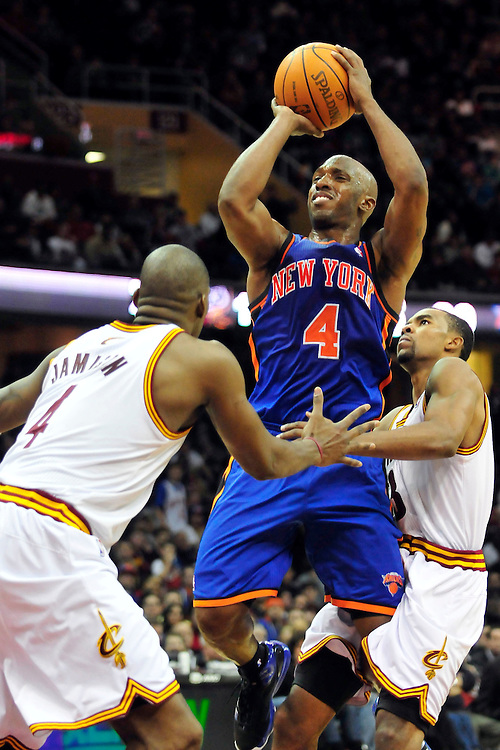 Feb. 25, 2011; Cleveland, OH, USA; New York Knicks point guard Chauncey Billups (4) shoots over Cleveland Cavaliers power forward Antawn Jamison (4) and point guard Ramon Sessions (3) during the fourth quarter at Quicken Loans Arena. The Cavaliers beat the Knicks 115-109. Mandatory Credit: Jason Miller-US PRESSWIRE