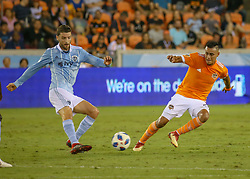 August 4, 2018 - Houston, TX, U.S. - HOUSTON, TX - AUGUST 04:  Houston Dynamo midfielder Darwin Ceren (24) keeps the ball away from Sporting Kansas City midfielder Ilie Sanchez (6) during the soccer match between Sporting Kansas City and Houston Dynamo on August 4, 2018 at BBVA Compass Stadium in Houston, Texas.  (Photo by Leslie Plaza Johnson/Icon Sportswire) (Credit Image: © Leslie Plaza Johnson/Icon SMI via ZUMA Press)