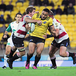 Ngani Laumape is tackled during the Super Rugby match between the Hurricanes and Lions at Westpac Stadium in Wellington, New Zealand on Saturday, 5 May 2018. Photo: Dave Lintott / lintottphoto.co.nz