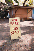 A sign at Kealakekua Bay on the Big Island warns people not to park in this space.