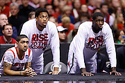 INDIANAPOLIS, IN - MARCH 29: Peyton Siva #3, Zach Price and Montrezl Harrell (from left) of the Louisville Cardinals look on against the Oregon Ducks during the regional round of the 2013 NCAA Men's Basketball Tournament at Lucas Oil Stadium on March 29, 2013 in Indianapolis, Indiana. (Photo by Joe Robbins)