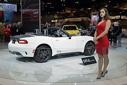 09 February 2017: Fiat 124 Convertible shown by a female Product Specialist<br /> <br /> First staged in 1901, the Chicago Auto Show is the largest auto show in North America and has been held more times than any other auto exposition on the continent.  It has been  presented by the Chicago Automobile Trade Association (CATA) since 1935.  It is held at McCormick Place, Chicago Illinois<br /> #CAS17