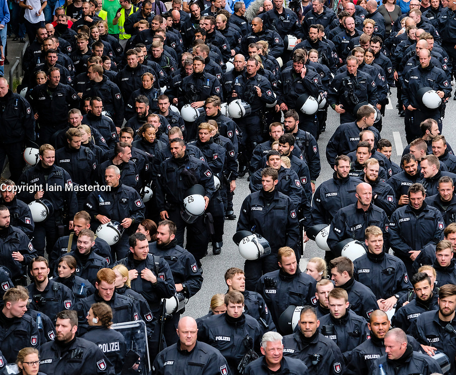8th July, 2017. Hamburg, Germany. large demonstration march through central Hamburg protesting against G20 Summit  in city. Here large group of police march in from of main protest march.