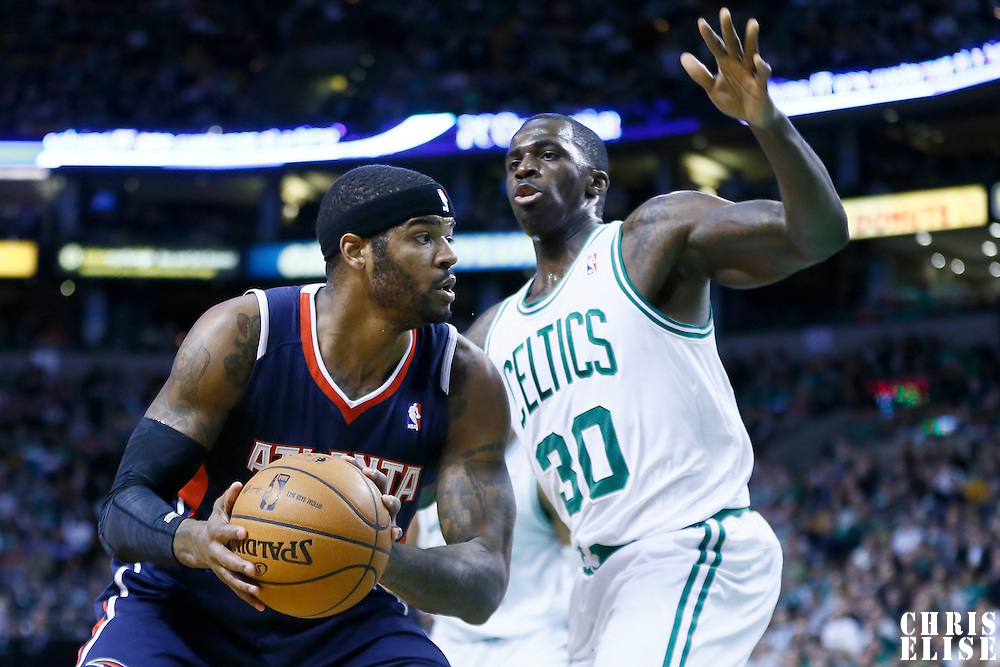 29 March 2013: Boston Celtics power forward Brandon Bass (30) defends on Atlanta Hawks small forward Josh Smith (5) during the Boston Celtics 118-107 victory over the Atlanta Hawks at the TD Garden, Boston, Massachusetts, USA.