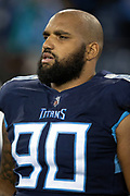 Tennessee Titans defensive end DaQuan Jones (90) looks on from the sideline during the week 14 regular season NFL football game against the Jacksonville Jaguars on Thursday, Dec. 6, 2018 in Nashville, Tenn. The Titans won the game 30-9. (©Paul Anthony Spinelli)