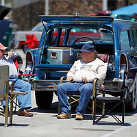 Thomas Wells | BUY at PHOTOS.DJOURNAL.COM<br /> Jim Hensley, left, and his friend, Scotty Bishop enjoy a chat early Friday afternoon as they finish setting up chairs around their cars.