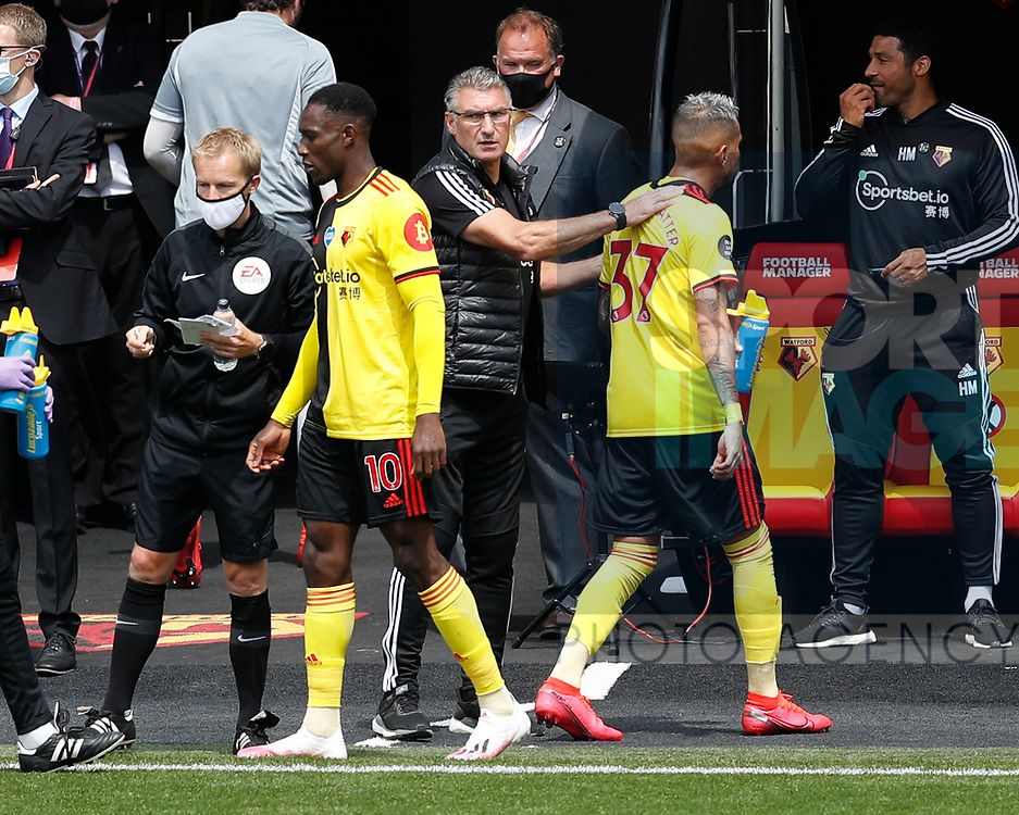 Danny Welbeck of Watford replaces Roberto Pereyra of Watford during the Premier League match at Vicarage Road, Watford. Picture date: 20th June 2020. Picture credit should read: Darren Staples/Sportimage