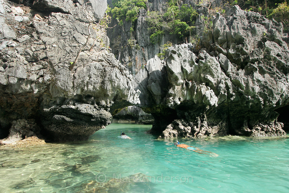 Entrance into the Small Lagoon, surrounded by limestone cliffs in the Bacuit Archipelago, El Nido, Palawan, Philippines.
