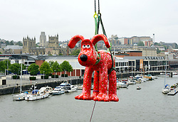 © Licensed to London News Pictures. 28/06/2013. Bristol, UK. A strawberry Gromit figure is hoisted by crane over Bristol docks as part of Gromit Unleashed in Bristol.  From Monday 1st July, Bristol will be home to 80 iconic giant Gromit sculptures as our public arts trail Gromit Unleashed takes to the streets.  The 5 foot high sculptures which have been painted by artists will be placed in various locations around Bristol and will eventually be auctioned for charity.  All proceeds from Gromit Unleashed will benefit Wallace & Gromit's Grand Appeal, the Bristol Children's Hospital Charity.  26 June 2013.<br /> Photo credit : Simon Chapman/LNP