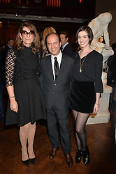 Left to right, MARTINE ASSOULINE, PROSPER ASSOULINE and ANNE HATHAWAY at a party to celebrate the launch of the Maison Assouline Flagship Store at 196a Piccadilly, London on 28th October 2014.  During the evening Valentino signed copies of his new book - At The Emperor's Table.