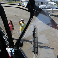 People look at the Spirit of North Carolina during Aviation Day Saturday October 11, 2014 at Wilmington International Airport in Wilmington, N.C. (Jason A. Frizzelle)