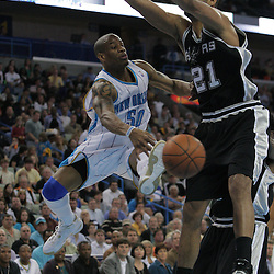17 December 2008:  New Orleans Hornets guard Antonio Daniels (50) passes the ball past defender San Antonio Spurs forward Tim Duncan (21) during a NBA regular season game between the Western Conference rivals the San Antonio Spurs and the New Orleans Hornets at the New Orleans Arena in New Orleans, LA..
