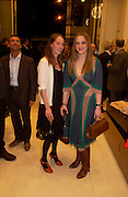 Poppy and Daisy de Villeneuve. H&M Flagship Store launch. at 17-21 Brompton Road, Knightsbridge. London. SW1. 23  March 2005. ONE TIME USE ONLY - DO NOT ARCHIVE  © Copyright Photograph by Dafydd Jones 66 Stockwell Park Rd. London SW9 0DA Tel 020 7733 0108 www.dafjones.com