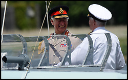 Image ©Licensed to i-Images Picture Agency. The Prince of Wales smiles as he sounds a horn on a boat as he and Duchess of Cornwall at Pegasus Bridge in Normandy, France, on the eve of the 70th anniversary of D-Day, Thursday, 5th June 2014 Picture by Andrew Parsons  / i-Images