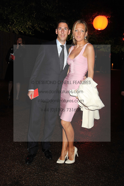 Property developer CHRISTIAN CANDY and EMILY CROMPTON at the annual Serpentine Gallery Summer Party in Kensington Gardens, London on 9th September 2008.