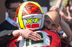 February 25, 2018 - Melbourne, Victoria, Australia - Spanish rider Xavi Fores (#12) of Barni Racing in congratulated by team mates after finishing in 3rd place after the second race on day 3 of the opening round of the 2018 World Superbike season at the Phillip Island circuit in Phillip Island, Australia. (Credit Image: © Theo Karanikos via ZUMA Wire)
