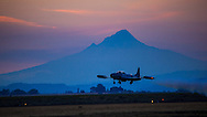 "Greg Colyer flying a ""dirty"" pass in his Canadair CT33 past Mt. Hood at sunset at the Airshow of the Cascades."