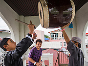 06 JULY 2016 - BANGKOK, THAILAND: A man bangs a drum at Bang Luang Mosque to mark the end of Ramadan after the end of Eid services at the mosque. Eid al-Fitr is also called Feast of Breaking the Fast, the Sugar Feast, Bayram (Bajram), the Sweet Festival or Hari Raya Puasa and the Lesser Eid. It is an important Muslim religious holiday that marks the end of Ramadan, the Islamic holy month of fasting. Muslims are not allowed to fast on Eid. The holiday celebrates the conclusion of the 29 or 30 days of dawn-to-sunset fasting Muslims do during the month of Ramadan. Islam is the second largest religion in Thailand. Government sources say about 5% of Thais are Muslim, many in the Muslim community say the number is closer to 10%.        PHOTO BY JACK KURTZ