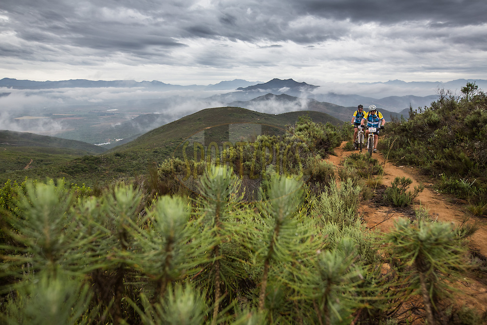 Jan Odendaal and Pieter Greyling during stage 1 of the 2014 Absa Cape Epic Mountain Bike stage race held from Arabella Wines in Robertson, South Africa on the 24 March 2014<br /> <br /> Photo by Karin Schermbrucker/Cape Epic/SPORTZPICS