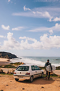 Getting ready to surf at Amado beach, Western Algarve