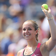 Sabine Lisicki, Germany, reacts while hitting signed tennis balls into the crowd after her victory over Paula Ormaechea, Argentina, during the Women's Singles competition at the US Open. Flushing. New York, USA. 29th August 2013. Photo Tim Clayton