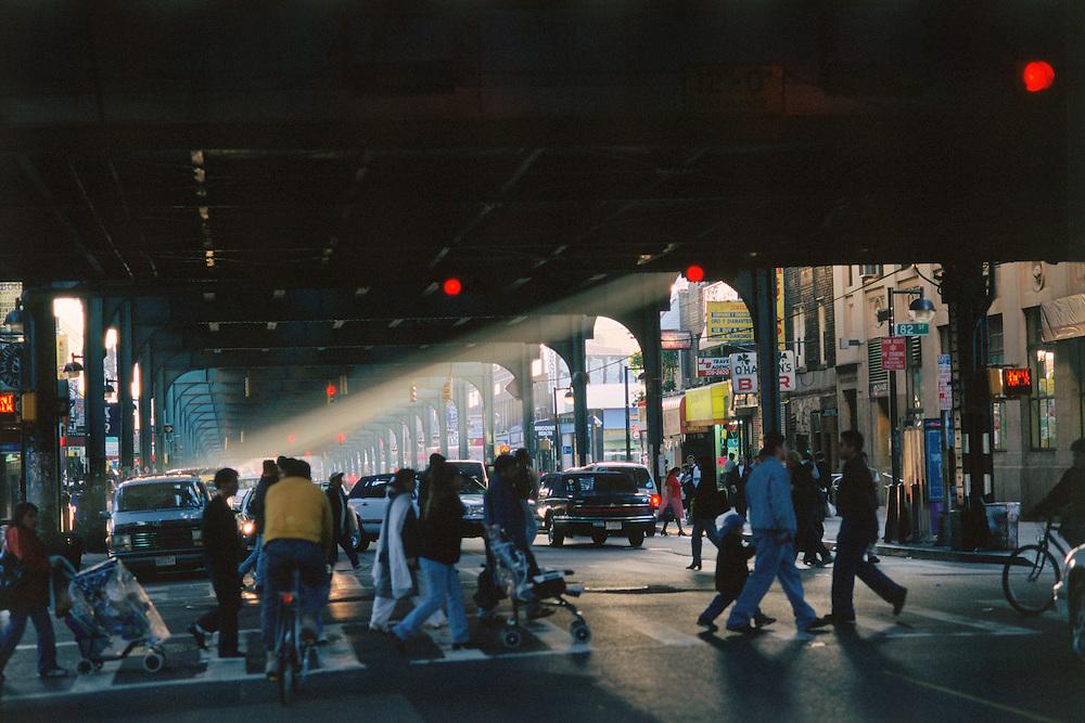 Under the Subway, Roosevelt Ave, New York City, Queens,Jackson Heights, Light beam, pedestrians crossing street