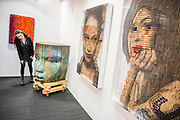 A portrait of Amy Winehouse made of corks, shot gun cartridges and mouse traps and Busts (incl the larger than life Jesus Curia sculpture - pictured)on the Modus Gallery Stand - London Art Fair for Modern British and contemporary art brings its 28th edition at the Business Design Centre, Islington, from 20-24 January 2016. The Fair includes 126 exhibitors ranging from established UK-based Modern British and contemporary galleries. Highlights include: Colin Davidson's portrait of Angela Merkel – the first UK showing of this iconic work, commissioned from the Irish artist by TIME magazine for their 2015 'person of the year' edition. The portrait is being hung alongside a new, unseen portrait of the British actor Simon Callow - Oliver Sears Gallery (Stand 42);; Viole, a large sculptural work by German born artist Dietrich Klinge, will be included as part of Venet-Haus Galerie's presentation - Venet-Haus Galerie (stand 4).
