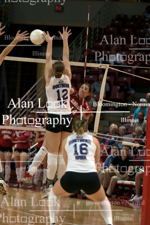25 September 2004     Laura Doornbos spikes past Shari Vermeer.    Illinois State University Redbirds V University of Northern Iowa Panthers Volleyball.  Redbird Arena, Illinois State University, Normal IL