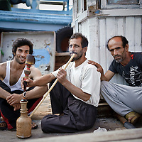 Dubai, United Arabs Emirates - 04 December 2008.Dockers, most of them from Iran, working at the Dubai's creek..Photo: EZEQUIEL SCAGNETTI.