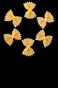 Pasta Varieties - Cute shape made with farfalle pasta isolated on black  background.