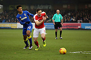 AFC Wimbledon striker Lyle Taylor (33) battles for possesion with Charlton Athletic midfielder Andrew Crofts (8) during the EFL Sky Bet League 1 match between AFC Wimbledon and Charlton Athletic at the Cherry Red Records Stadium, Kingston, England on 11 February 2017. Photo by Matthew Redman.