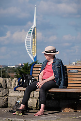 © Licensed to London News Pictures. 09/10/2015. Southsea, Hampshire, UK. People enjoying the warm and sunny October weather next to the Solent in Southsea in Hampshire. Photo credit : Rob Arnold/LNP