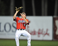 Mississippi's Will Jamison (4) makes a catch vs. Louisiana-Lafayette in an NCAA Super Regional game in Lafayette, La. on Sunday, June 8, 2014. Mississippi won 5-2.