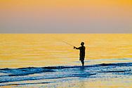 Surf fishing at sunset, Gulf of Mexico, Sanibel Island, Florida