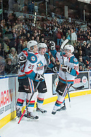 KELOWNA, CANADA - FEBRUARY 18: Lucas Johansen #7 of Kelowna Rockets celebrates his first WHL goal with Joe Gatenby #28 and Gage Quinney #20 against the Kamloops Blazers on February 18, 2015 at Prospera Place in Kelowna, British Columbia, Canada.  (Photo by Marissa Baecker/Shoot the Breeze)  *** Local Caption *** Lucas Johansen; Gage Quinney; Joe Gatenby;