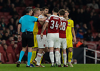Football - 2018 / 2019 UEFA Europa League - Round of Thirty-Two, Second Leg: Arsenal (0) vs. BATE Borisov (1)<br /> <br />  Tempers flare towards the end after a poor challenge and Sokratis Papastathopoulos (Arsenal FC) pulss Granit Xhaka (Arsenal FC) away at The Emirates.<br /> <br /> COLORSPORT/DANIEL BEARHAM