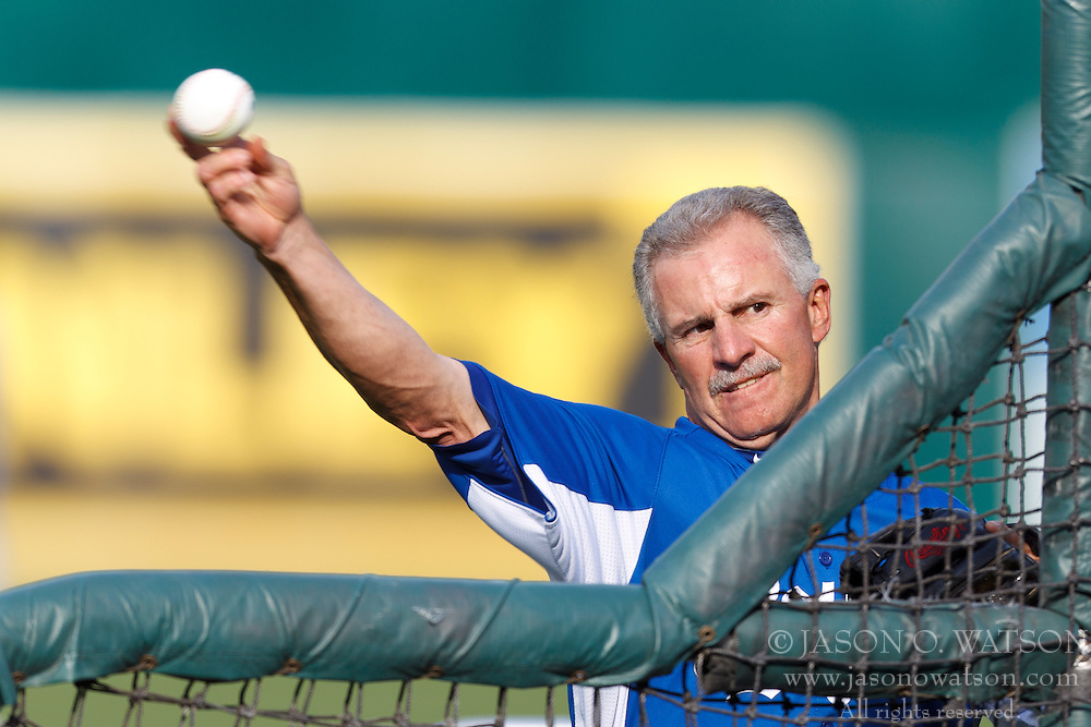 April 9, 2012; Oakland, CA, USA; Kansas City Royals third base coach Eddie Rodriguez (14) pitches during batting practice before the game against the Oakland Athletics at O.co Coliseum.  Oakland defeated Kansas City 1-0. Mandatory Credit: Jason O. Watson-US PRESSWIRE