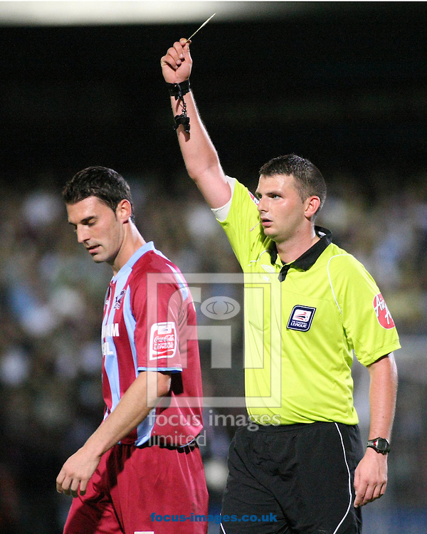Scunthorpe - Tuesday August 18th, 2009: Referee Michael Oliver shows Matt Sparrow of Scunthorpe United a yellow card during the Coca Cola Championship match between Scunthorpe United & Middlesbrough at Glanford Park Scunthorpe. (Pic by Steven Price/Focus Images)...