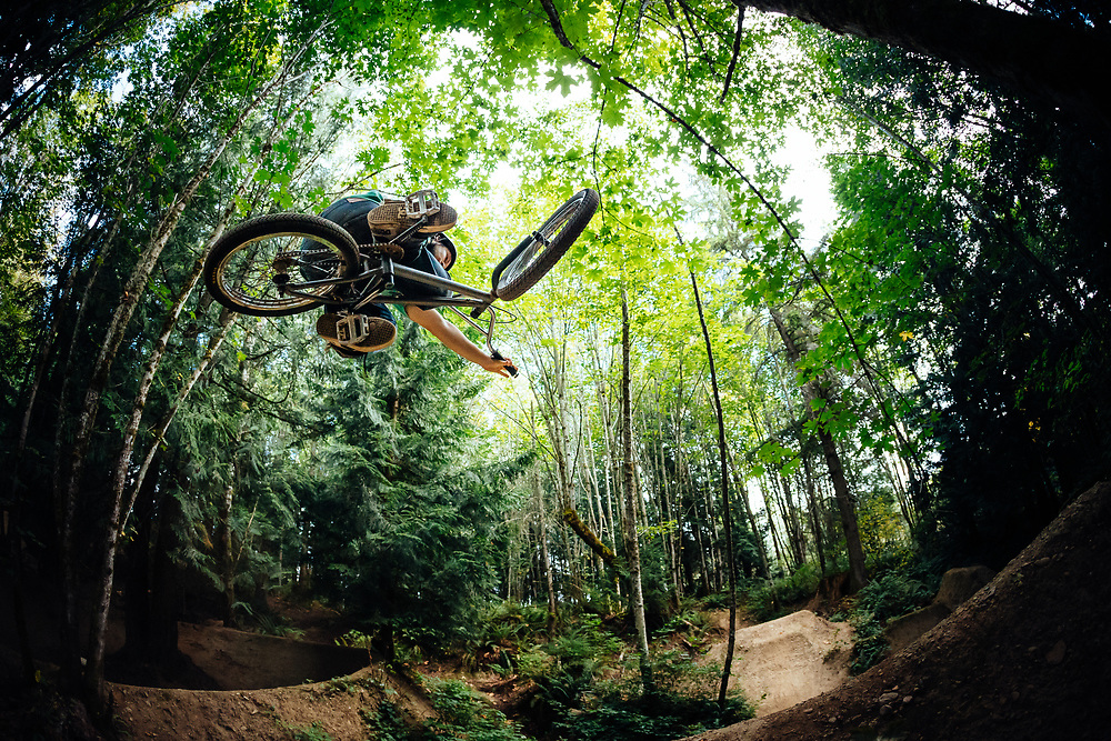 Andy Grant grabs some major hangtime in the woods of the Pacific Northwest near Bellingham, Washington.