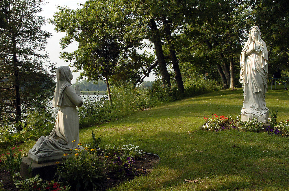 Statue of the Blessed Mother appearing to St. Bernadette. Scene from Redemptorist Retreat Center in Oconomowoc, Wis. (Photo by Sam Lucero)