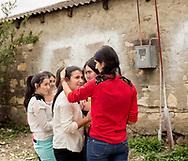 EN:Girls playing in the patio of a school in the Azeri village of Iormuganlo.<br /> Secondary-school education through 12th grade is compulsory in Georgia, but many families often do not see why a teenage girl should pursue an education, if her primary role will be housekeeping and childrearing.<br /> Kakheti region, Georgia, 2016.<br /> SP: Chicas charlan en el patio de una escuela. Aunque la educación secundaria sea obligatoria hasta los 16 años, en muchos entornos rurales es común que las chicas abandonen los estudios antes para convertirse en esposas y madres.
