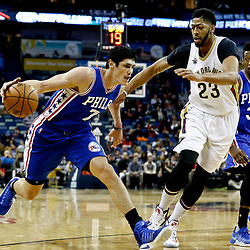 Dec 8, 2016; New Orleans, LA, USA;  Philadelphia 76ers forward Ersan Ilyasova (7) drives past New Orleans Pelicans forward Anthony Davis (23) during the first quarter of a game at the Smoothie King Center. Mandatory Credit: Derick E. Hingle-USA TODAY Sports