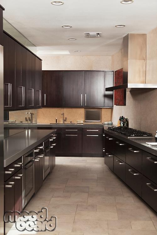 Dark wood galley kitchen