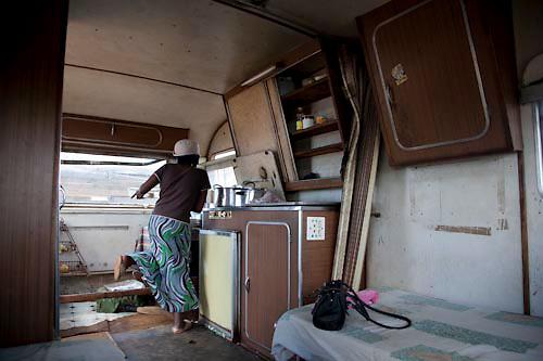 A woman who runs a restaurant from a caravan dances, Blinkwater, near Stoffberg, Mpumalanga. Dec 2008. Photo Mpho Khwezi